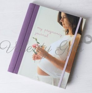 Дневник за бременността с бременна жена на корицата